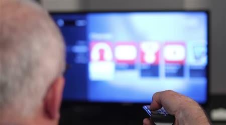 depositphotos_49076609-stock-video-smart-tv-and-senior-man