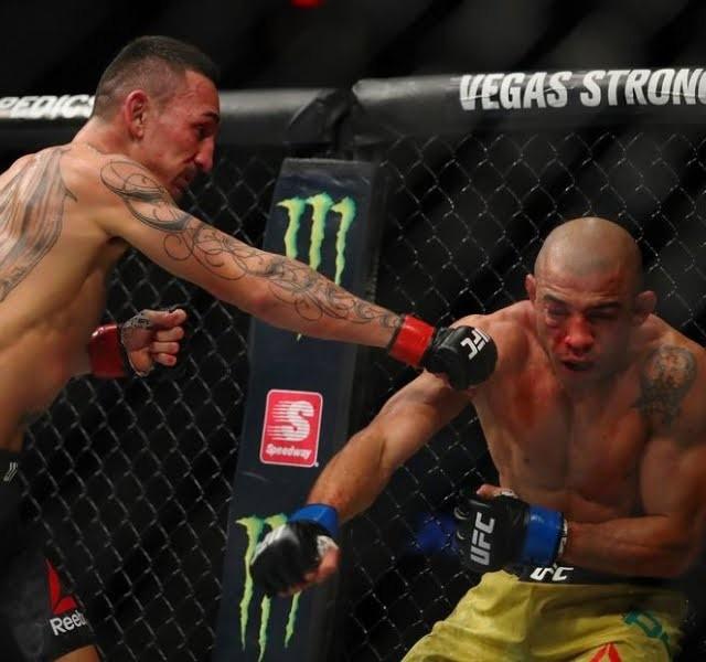 O campeão americano conquista sua 12ª vitória consecutiva no UFC.